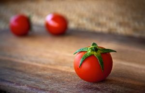 two petite tomatoes