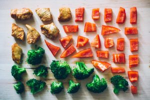 sliced broccoli and red bell pepper